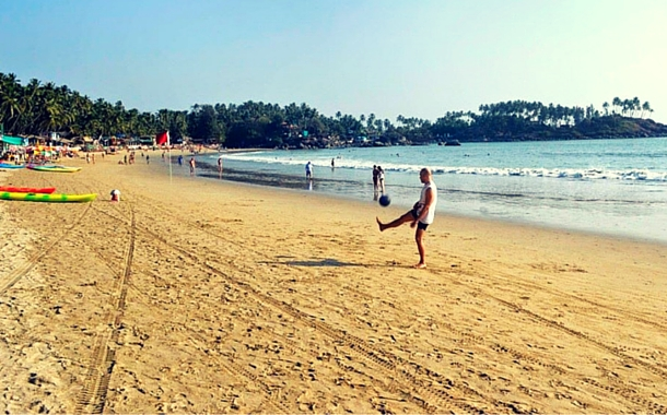 A man playing football at Goa beach
