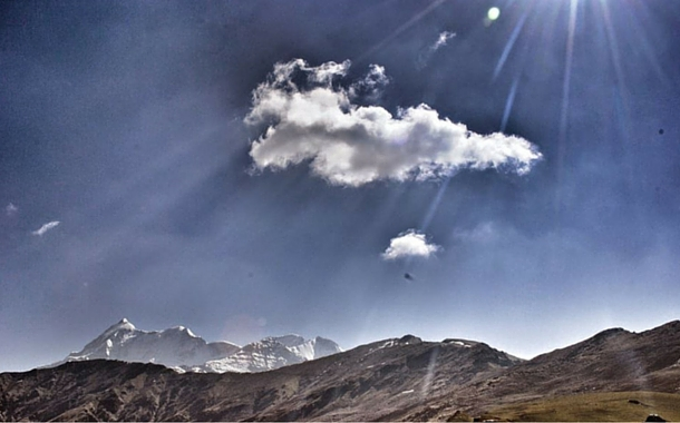 Sunrays falling on the snow-capped mountains, Uttarakhand